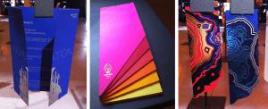 Ontwerpen op fel gekleurd papier te zien op papier-tentoonstelling Pop Up Exhibitions Amsterdam
